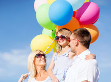 Family with colorful balloons Royalty Free Stock Images