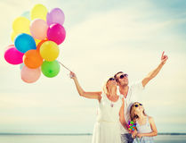 Family with colorful balloons royalty free stock image