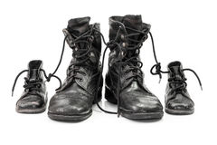 Family of combat boots Stock Image