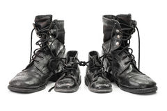 Family of combat boots Stock Photography