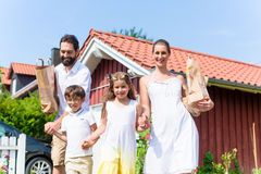 Family coming home from shopping groceries Stock Images