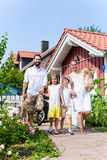 Family coming home from shopping groceries Stock Photography