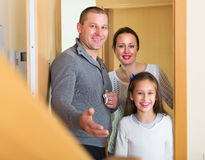 Family coming inside mortgage house Royalty Free Stock Images