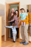 Family coming to grandmother  home. Cheerful family of four coming to grandmother  home Royalty Free Stock Photos