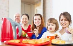 Family communicate around tea table Stock Photo