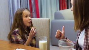 Family communication child balanced nutrition milk. Family communication. mother`s care of child`s balanced nutrition. dairy products. milk and cookies stock footage