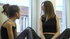 Family communication sporty fit mother child talk. Family communication. sporty and fit mother and child daughter talking. workout break stock footage