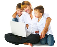 Family computer. Mother with two sons using laptop Stock Image