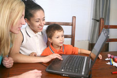 Family on the computer Royalty Free Stock Images