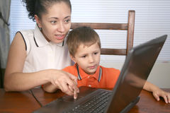 Family on computer Stock Images