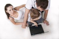 Family and computer Royalty Free Stock Photo