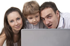 Family and computer Royalty Free Stock Photography