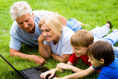 Family with computer Royalty Free Stock Photo