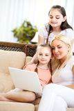Family with computer Stock Photos