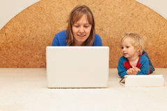 Family with computer at home Stock Photos