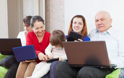 Family of with computers  at home Stock Photo