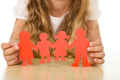 Family concept. Kids concept of family with little girl holding paper people - closeup stock images