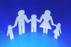 Family Concept. Paper Chain Family Holding Hands on Blue background royalty free stock photography