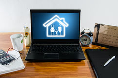 Family concept on computer on desktop Royalty Free Stock Photos