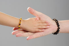 Family concept   father and daughter hands together Royalty Free Stock Photography