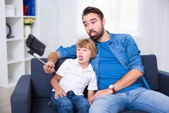 Family concept - funny young father and his little son taking se Royalty Free Stock Image