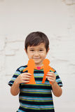 Family concept with little boy holding up paper chain shaped like a traditional couple with heart stock image