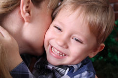 Family concept. A little boy hugs his mother's neck. Happy child Royalty Free Stock Photo