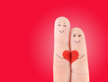 Family concept - man and woman hold on the red heart Royalty Free Stock Photography