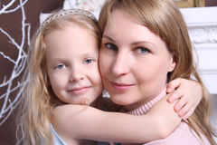 Family concept.  Mom and daughter. Family concept. Mom and daughter sit hugging Royalty Free Stock Image