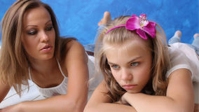 Family concept. Mother and daughter talking teenager. Child unhappy, she was upset. Teens in Crisis. The similarity of mother and daughter. Blondes Royalty Free Stock Images