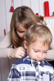 Family concept. Mother and son. Mom helps fasten a bow tie Stock Image