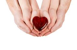 Family concept - parents' hands holding child hands with heart Stock Images