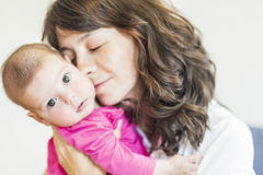 Family Concept: Portrait of Young Mother Taking Care of Her Litt Royalty Free Stock Images