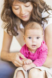 Family Concept: Portrait of Young Mother Taking Care of Her Litt Stock Photos