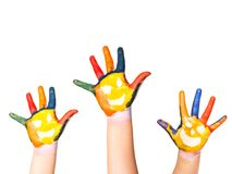 Family concept. Three colorful hands with smiling face of family - mother, father and baby. Small, medium and large hand. Symbol u Stock Photography