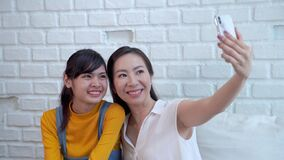 Family concept video,Southeast Asian mother and daughter are happy selfies
