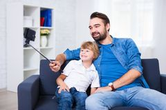 Family concept - young father and his little son taking selfie p Royalty Free Stock Photo