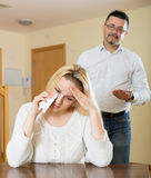 Family conflict at home. Man consoling young depressed crying blonde women at home Royalty Free Stock Photo