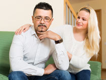 Family conflict at home. Man has problem, loving women comforting him in the living room at home Stock Photo