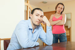 Family conflict. Middle-aged couple after quarrel. In living room at home Royalty Free Stock Photo