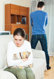 Family conflict. Sadness woman against standing man. Family conflict. Sadness women against standing men at home Royalty Free Stock Photo