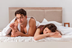 The family conflict with wife husband in bed Royalty Free Stock Images