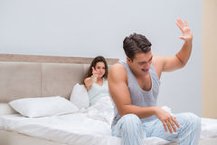 The family conflict with wife and husband in bed. Family conflict with wife and husband in bed Royalty Free Stock Photos