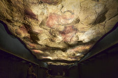 Family contemplate the Altamira replica cave at National Archeol