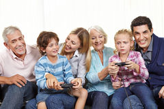 Family with controller playing Royalty Free Stock Image