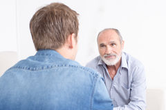 Family conversation between father and son Royalty Free Stock Image