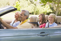Family in convertible. Happy smiling family members in convertible automobile Royalty Free Stock Photo