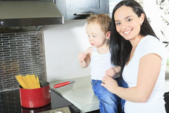 Family cook pasta inside the kitchen stock photography