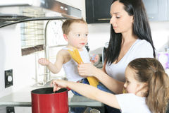Family cook pasta inside the kitchen Royalty Free Stock Photo