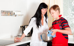 Family cooking. Mother and son in kitchen royalty free stock image